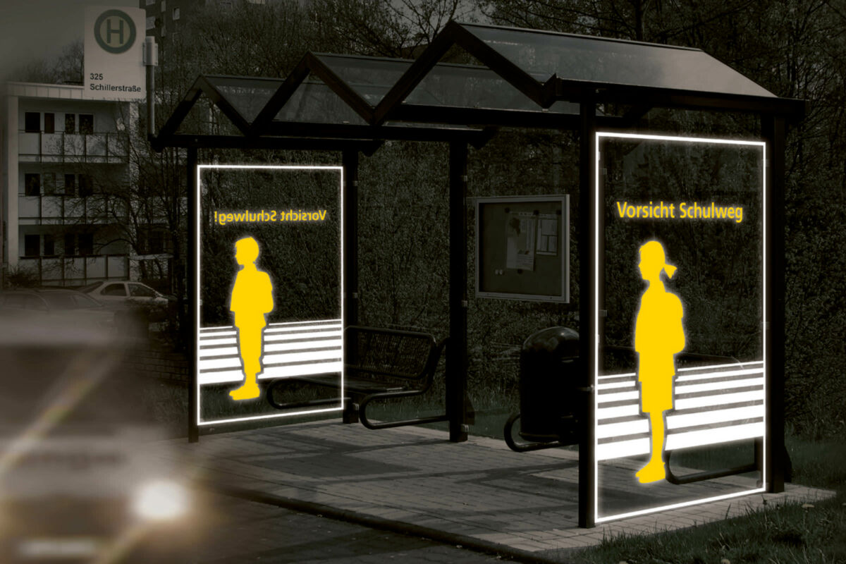 Light reflecting special foil on a bus stop at night