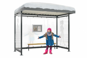 Ein junges Mädchen steht vor einer verschneiten Überdachung