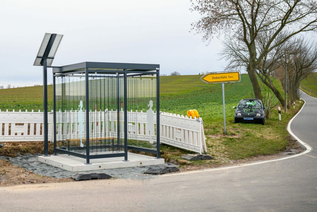 Bus stop with photovoltaic system on a country road